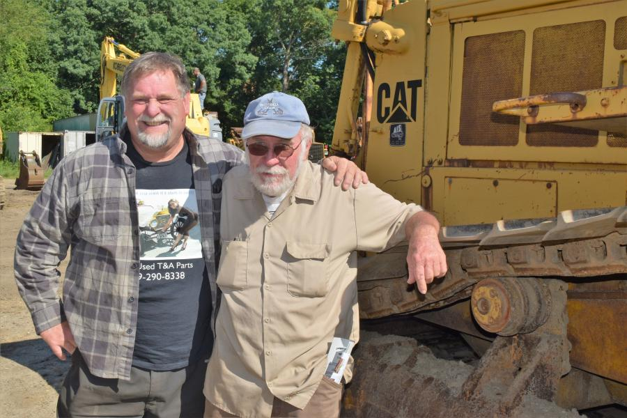 With a Cat D7 crawler, Alan Samuelsen (L) from Weekstown, N.J., and Ray Gifford from Southampton, N.J., are at the sale primarily to show support to their friend, Richard Giberson.