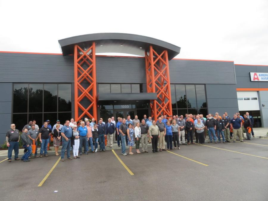 Employees gather for a group shot to celebrate the company's 50th anniversary.