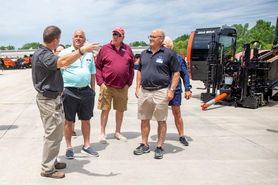 Mark Harbaugh (L), president of Ditch Witch Midwest, welcomes guests to the company's new facility.