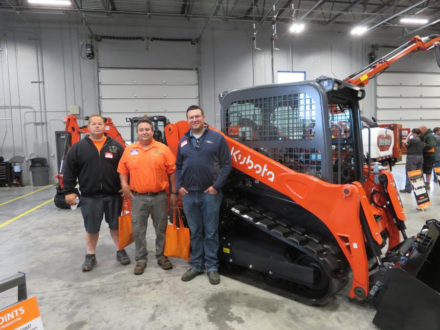 Mike Ford (R) of 1ST Choice Equipment Co. shows this Kubota SVL75-2 skid steer to Dewey Klodzinski (L) and Pete Castillo, both of Razor Edge Landscaping.