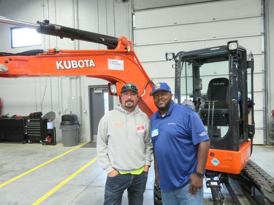 Jim Rollins (L) and David Harris, both of North Shore Gas, have a look at this Kubota U35-4 excavator.