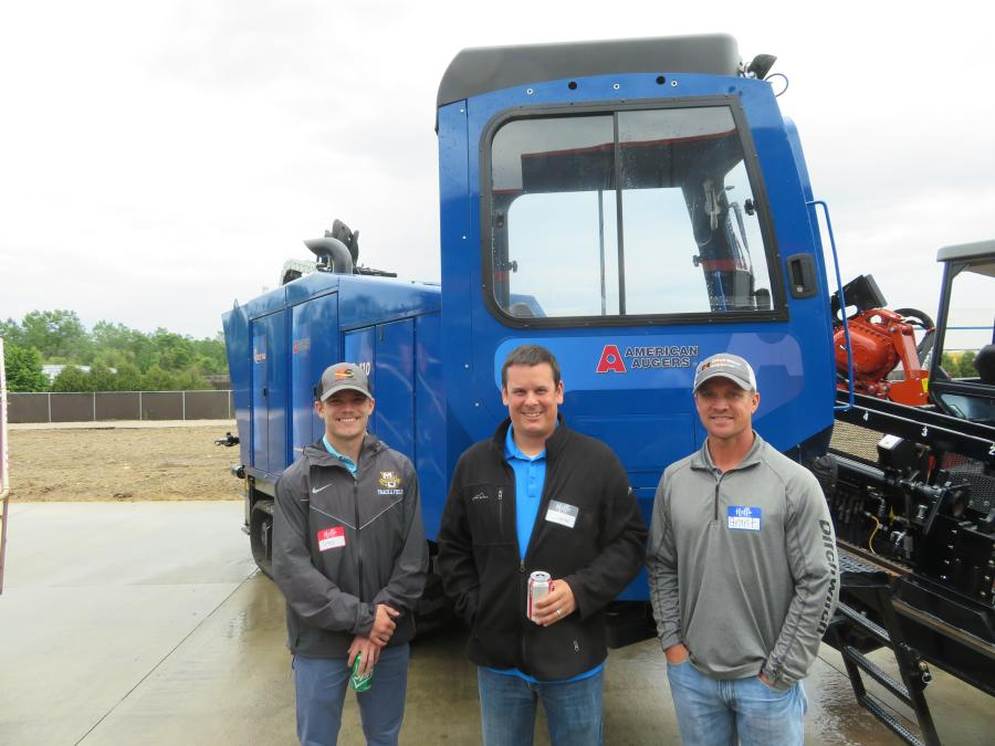 Grant Ketterhagen (R) shows this American Auger DD110 to Greg Van Hollen (L) and Shane Wolf, both of K S Energy Services.