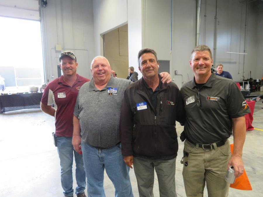 Mark Harbaugh (R), president of Ditch Witch Midwest, gives a tour of the new facility to (L-R) John Granberg and Robin Gilbertson, both of J&R Underground, and Phil Bongi of Bongi Construction.