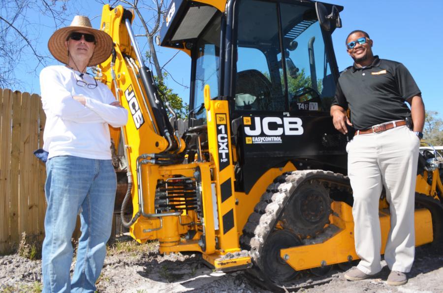 Scott Bilhardt (L) and his Briggs JCB sales representative, Darius Prentice, talk about the upcoming jobs for which Bigdogz Crane & Tree will be using the versatile JCB 1CXT compact backhoe loader.
