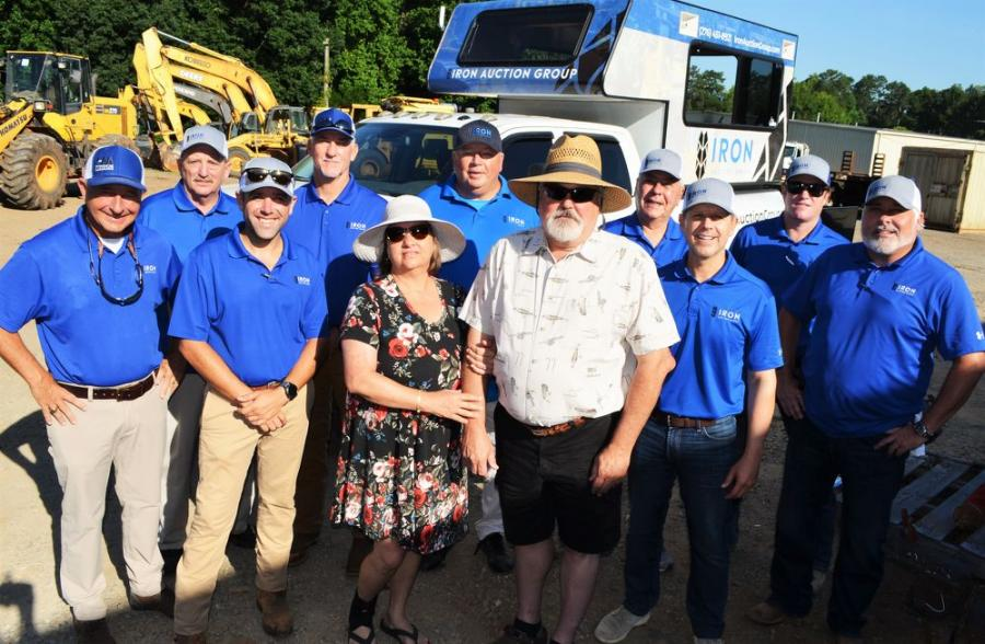 Total Development Inc. owners Chris and David McConnell (C), flanked by the Iron Auction Group staffers, are ready and excited for a big sale day of machines, trucks, support equipment and tools in Acworth, Ga.