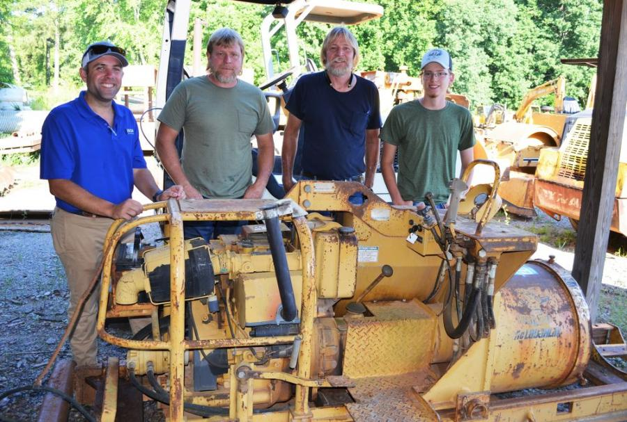 Discussing the McLaughlin Mighty Mole drilling machine about to be sold (L-R) are  Jared McGaffee of Iron Auction Group; and Russell, Terry and Dylan Lanning of Lanning Contracting, Cartersville, Ga.