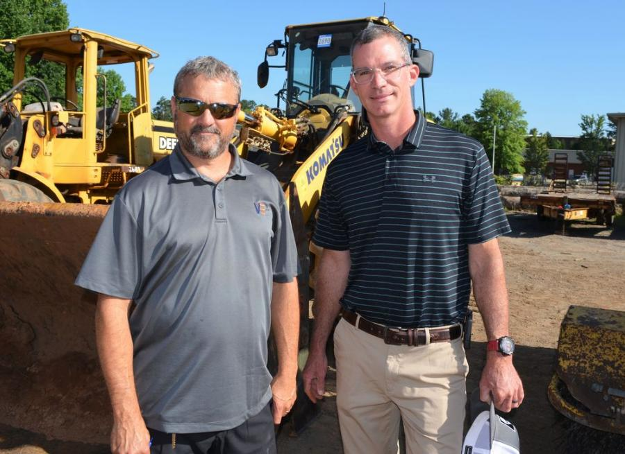 """Looking over one of the """"stars of the show,"""" a 2018 Komatsu WA270 wheel loader, are Kerry Grindle (L) and Brett Johnson of Vertical Earth, Cumming, Ga."""