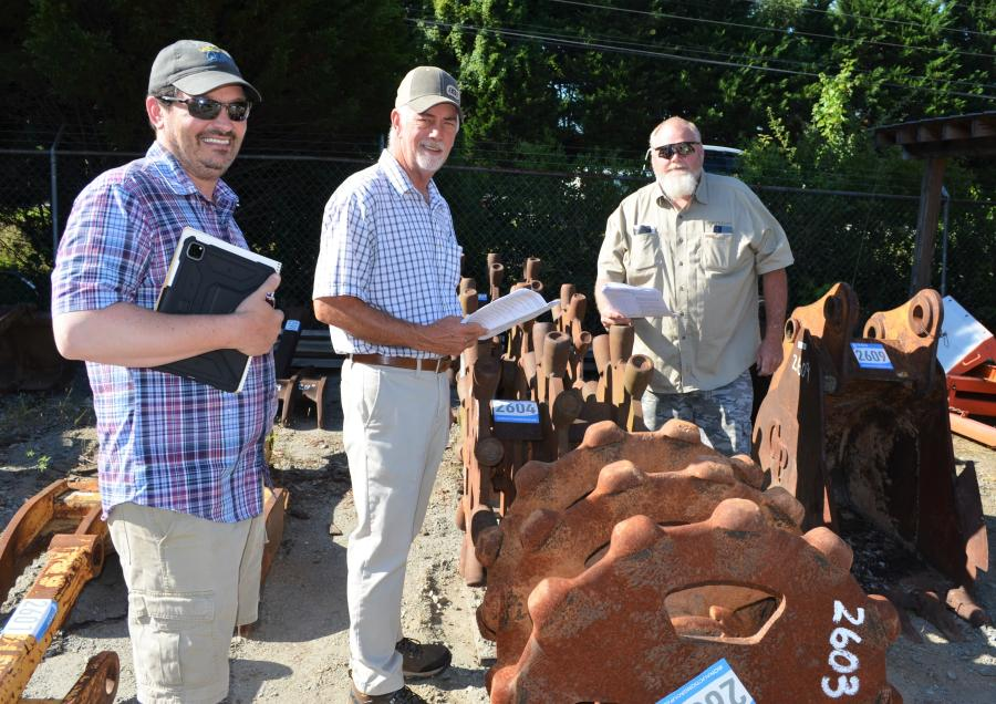 (L-R): The broad selection of attachments was of interest to  David and Scott Gilleland, and Robbie Worley of Clyde Gilleland Contractor Inc., Jasper ,Ga.