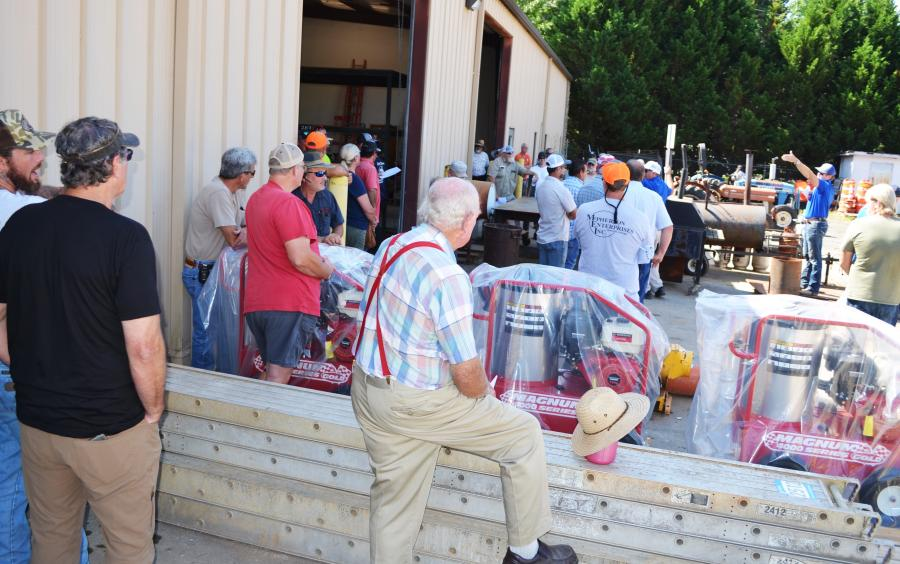 A big crowd of registered bidders had already assembled as the sale began with auctioning of miscellaneous items and tools.
