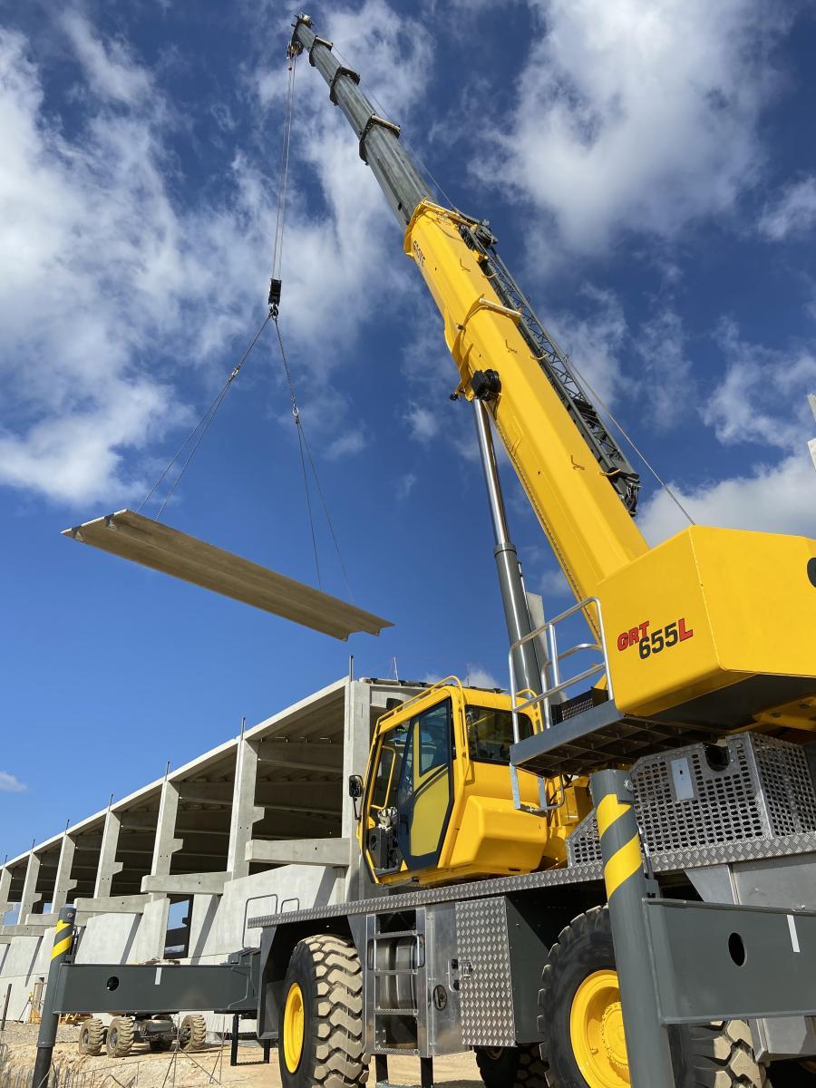 A Grove GRT655L rough-terrain crane at work installing a precast concrete structure.