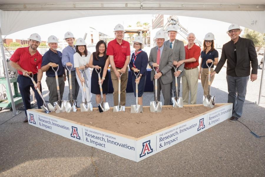 """The University of Arizona held a groundbreaking ceremony for its new Applied Research Building on Tuesday, June 29. Attendees and speakers included university President Robert C. Robbins (fifth from R) and Elizabeth """"Betsy"""" Cantwell, senior vice president for research and innovation (sixth from R). (University of Arizona photo)"""