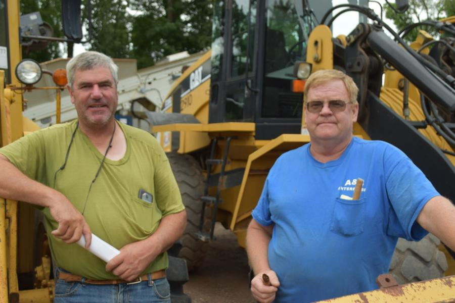 Taking in the sale and checking out a few Cat loaders are Phil Raudat (L) from Madison, Conn., and Ernie Rogan of A & S Construction in Middletown, Conn.