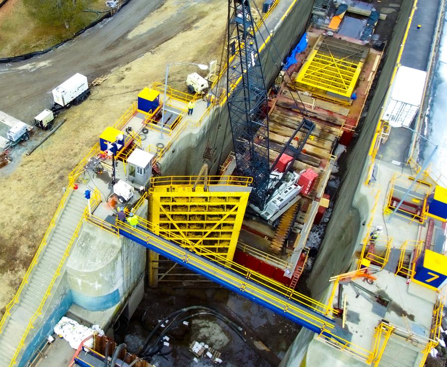 Following installation of sheet piling and draining the lock with a coffer dam, D.A. Collins lowered the 248 HYLAB 5 crane down into the dry lock to lift, remove, and position the 100,000 lb. (45,359 kg) lock gates for repairs.