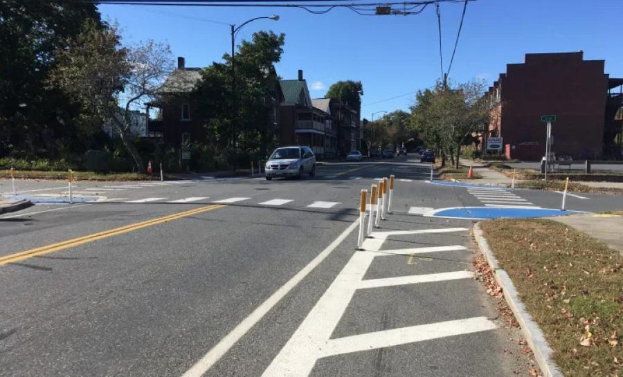 A Shared Streets and Spaces project in Montague's Turners Falls village used paint and flexible bollards to narrow intersections shorten crosswalks on Third Street. Montague recently won grant funds to make these changes permanent with more durable materials. (Franklin Regional Council of Governments photo).