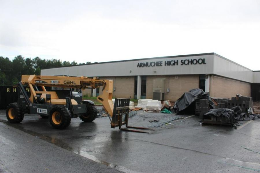 Workers are fixing up the exterior brickwork to match the new gym at Armuchee High School. (Rome News-Tribune/Olivia Morley photo)