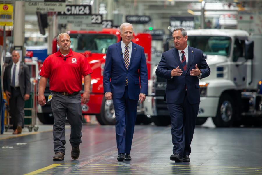 (L-R) are UAW Local 677 Shop Chairman Kevin Fronheiser; President Joe Biden; and Martin Weissburg, Mack Trucks president, at Mack's LVO facility.