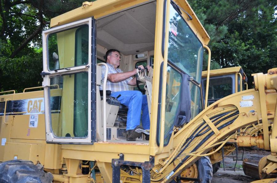 Test operating a Cat 12H motor grader is Wendell Cain of Cain & Todd Equipment, Lilburn, Ga.