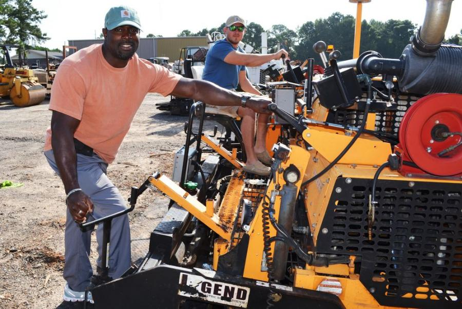 Giving this LeeBoy 8510C a good once over before it went on the auction block are Darrell Perry (L) and Chase Hardeman of H&H Paving, Rainsville, Ala.