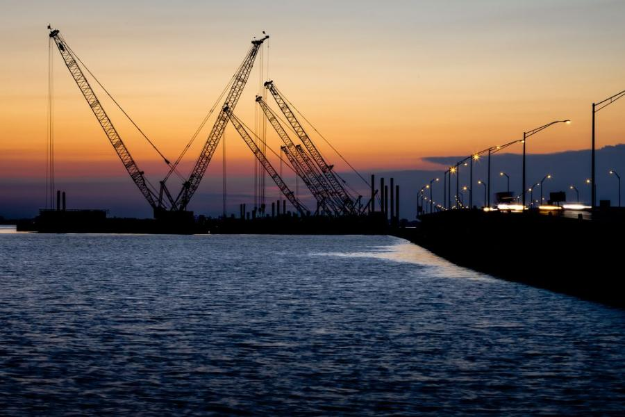 Cranes at sunset on FDOT's new southbound/westbound interstate bridge over Old Tampa Bay project. (Florida Department of Transportation photo)