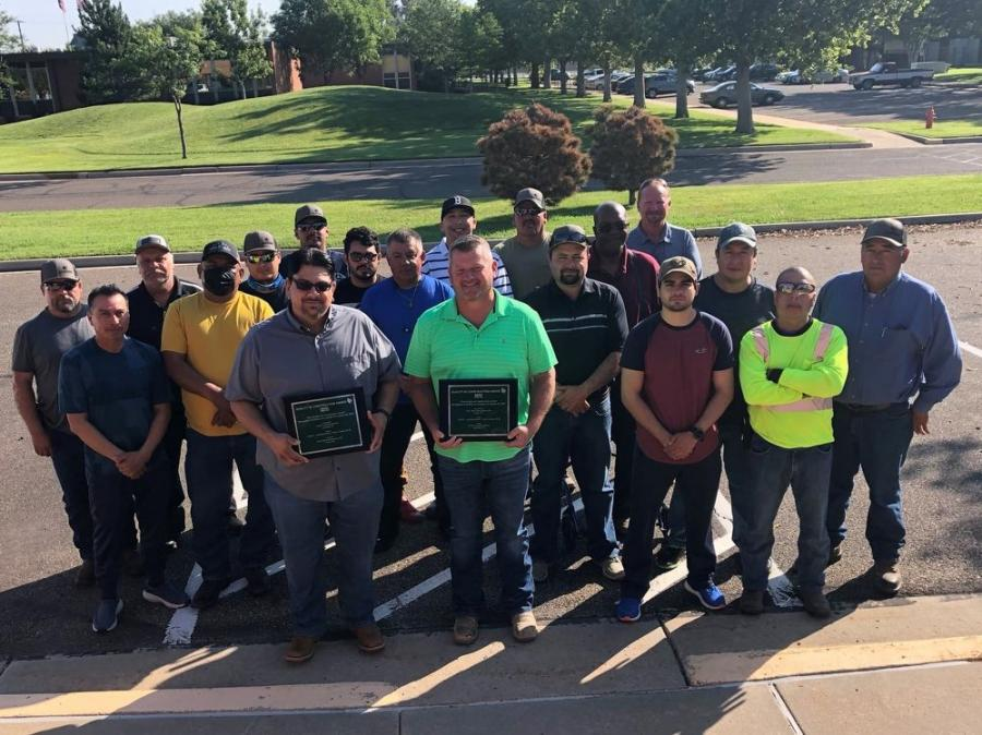 The RK Hall team celebrates the award for the I-40/US 60 hot mix overlay project in Potter County, a 4.5 mi.-long project that featured three bridges in each direction.
