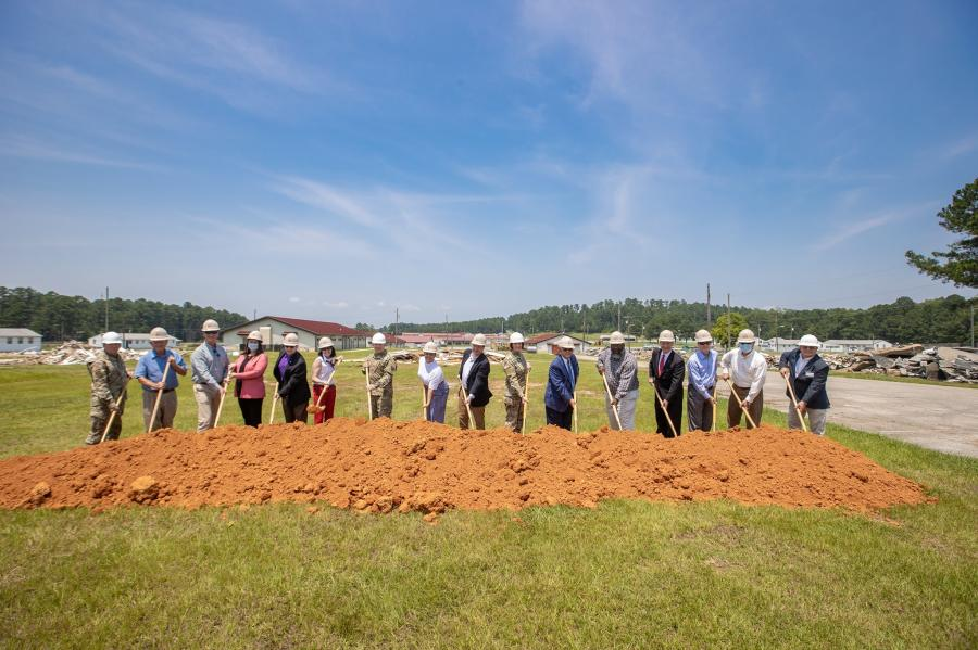 Representatives from the Alabama National Guard, state, county and city governments, and the design, architecture, and construction firms involved in the development pose for a photo at a ceremony on the site of the new barracks project. Pictured are Adjutant General Maj. Gen. Sheryl Gordon; Anniston Mayor Jack Draper; Representative K.L. Brown; City Councilman Demetric Roberts; City Councilwoman Ciara Smith; Post Commander Col. Jeffrey Smith; Jacksonville State University President Don Killingsowrth; ALNG Senior Enlisted Leader Command Chief Master Sgt. David Bullard; Linda Hearn; Charles Keith Jr.;  Mark Hearn; Aaron Acker; Julie Moss; Mike Rutland; Robert Garris; and Sean Smith. (Alabama National Guard photo)