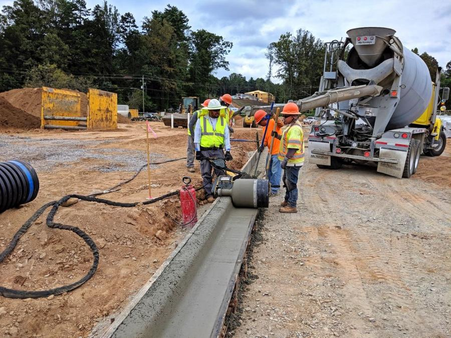 Curb Roller Manufacturing's curb roller CM4000, a single-operator machine for shaping concrete, reduces the labor of shaping curb and gutter pours, allowing crews to complete work up to twice as fast as manual methods or face forming.