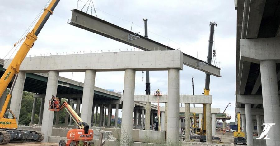 Cranes lift the first 115-ton concrete beam into place on the new southbound Mile Long Bridge while another 64 concrete beams — some measuring up to 187 ft. long — will be installed there this month as crews work to complete the structure on I-294. The new 4,800-ft.-long bridge is scheduled to open to drivers by the end of 2022. (Illinois Tollway photo)