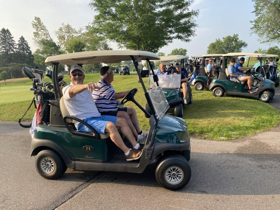 AGC Board Chair Jeff Carlson of Park Construction Co. heads out to tee off.