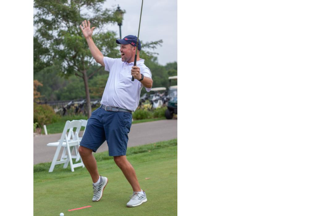 One of six golfers who sunk the putt in the putting contest celebrated his accomplishment.