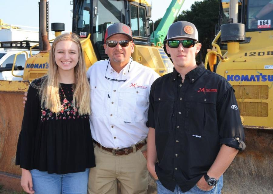 Joey Martin (C) and his children, Alexandria and Jayse, were all working together to get the Carrollton, Ga., auction ready to roll.