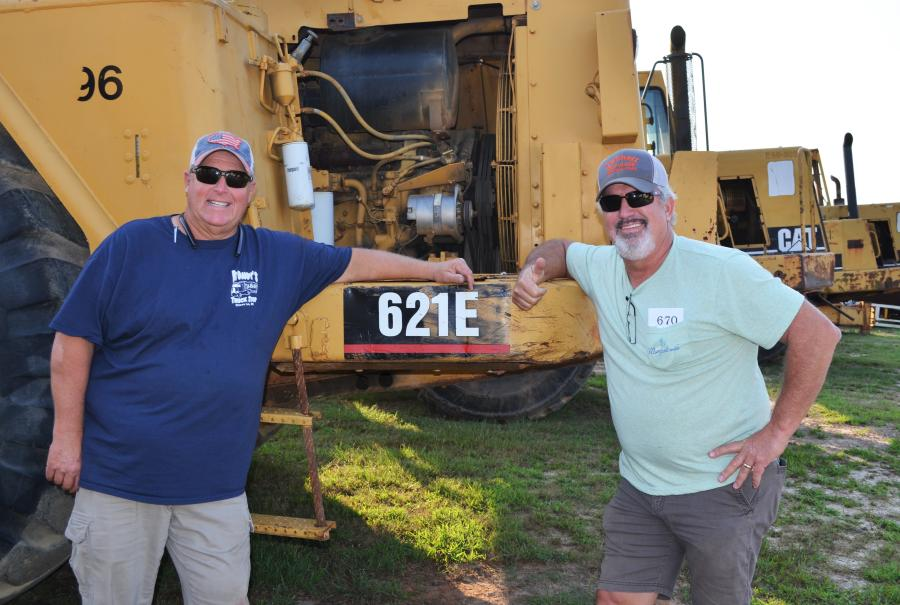 Enjoying their day and looking for bargains on the big earthmoving equipment, including a package of Cat scrapers, are Robbie Franklin (L), Triple R Metals, Odenville, Ala., and Allan Tunnell of Tunnell Services based in Pell City, Ala.