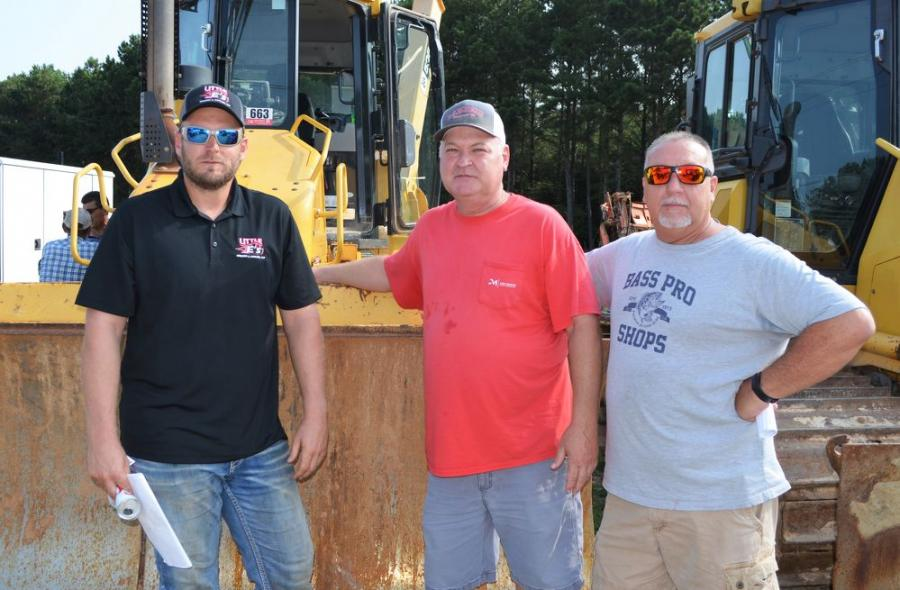 (L-R): Ellis Astin Jr., Little E's Grading & Hauling, Villa Rica, Ga.; Mike Clower, Joey Martin Auctioneers; and Mark Perry, Mark Perry Hauling & Grading, Cedar Bluff, Ala., had their game faces on while the heavy machines were being auctioned.