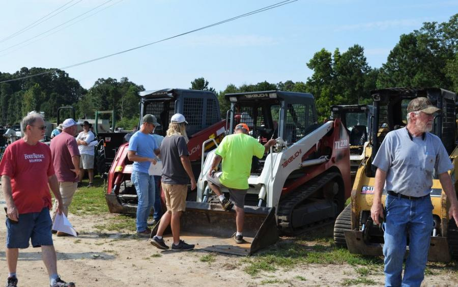 Bidders take one final look at a tremendous package of mini and compact machines before they went on the block.