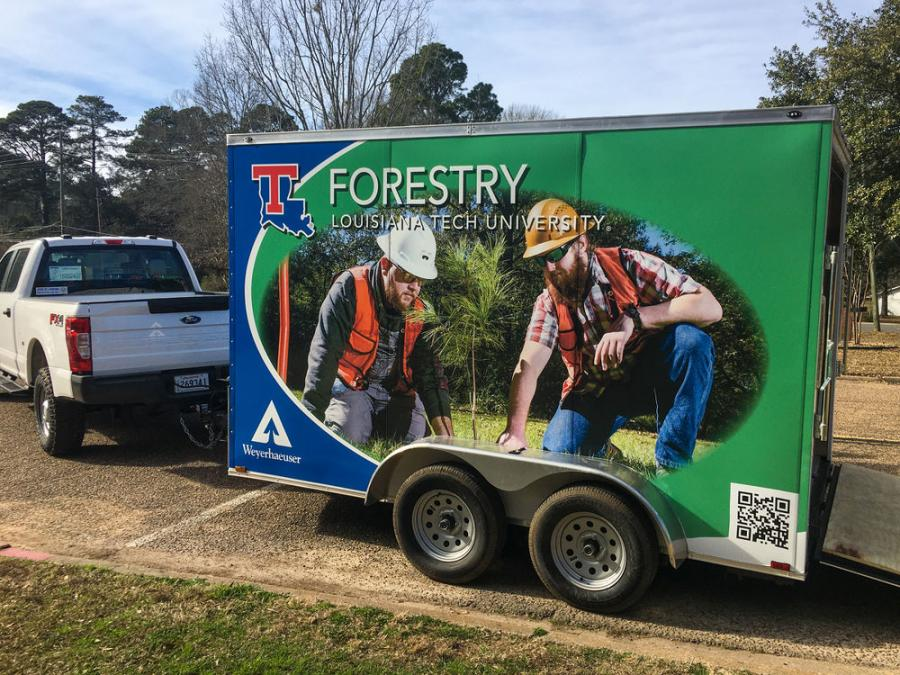 """The 7×12-ft. trailer is wrapped with a custom-made overlay designed by Elena Parker of Tech's University Communications that features both the Forestry Program (""""The future is GROWING"""") and Weyerhaeuser."""