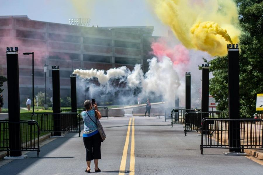 Smoke billows out of canisters to celebrate the groundbreaking ceremony of the new chemistry building on Aug. 24, 2021. (Joe Ryan/The Diamondback photo)