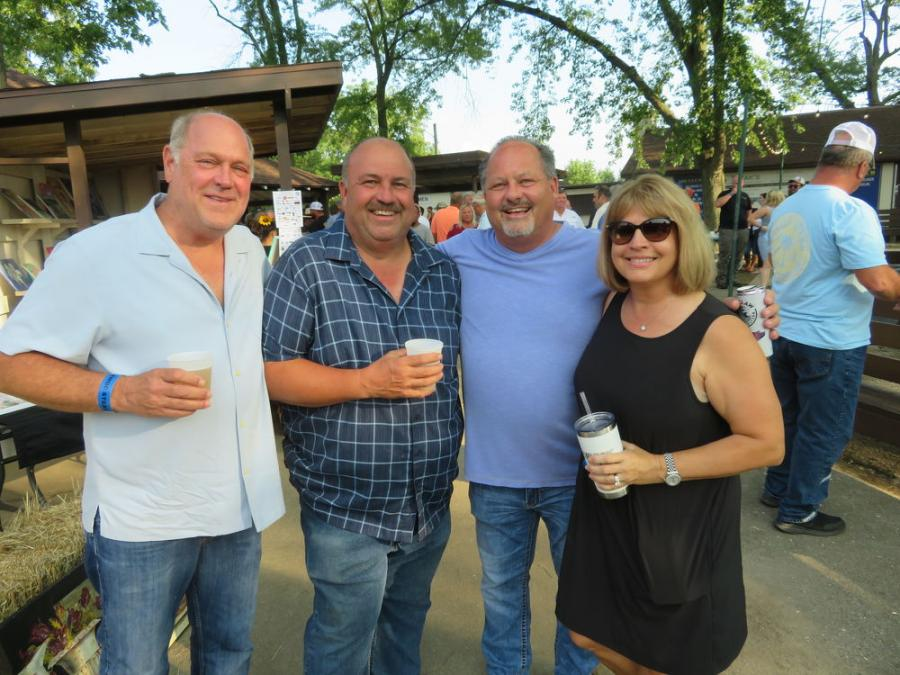 """(L-R) are Barry Narvick, president of Narvick Brothers Ready Mix Concrete; Tim Harty, general manager of Narvick Brothers Ready Mix Concrete; Kenny Sandeno, president of """"D"""" Construction Inc.; and Diane Narvick."""