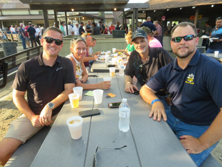 (L-R): Colin Glennon of LaFarge Holcim joins West Side Tractor Sales Co.'s Meghan Hargrave, sales manager; Wayne Massad, sales representative; and Mark Gronkiewicz, sales representative, for a bite to eat at CAWGC's annual Steak Fry.