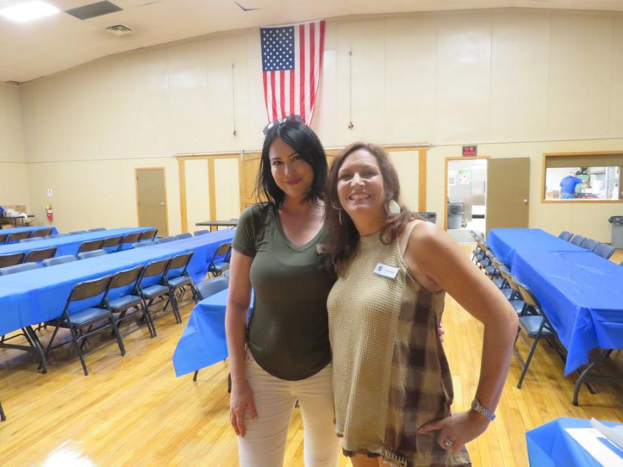 Kristie Cichon (L) and Carla Liburdi, both of CAWGC, welcome everyone to the annual steak fry.