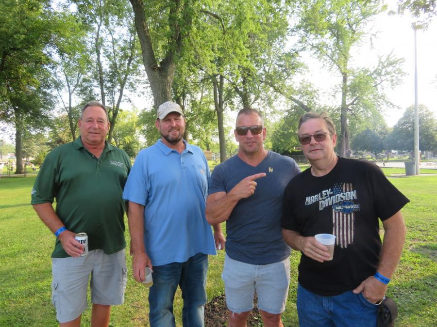 (L-R): Enjoying the annual steak fry are Ed Liesch of Underground Pipe and Valve Co.; Ted Stipanovich of Stip Bros. Excavating Inc.; Pete Valek of Lindbald Construction; and Gary Adams of CR Leonard Plumbing and Heating.