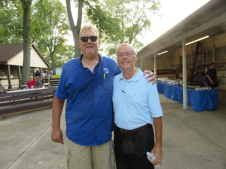 """Les Chaney (L), executive director of CAWGC, and Ken Wilhelmi, retired from """"D"""" Construction Inc., caught up at the Steak Fry."""
