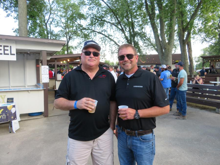 Finkbiner Equipment Co.'s Don Fitzgerald (L), service director national accounts, and Jerry Joynt, sales representative, took some time to mingle at CAWGC's annual Steak Fry.