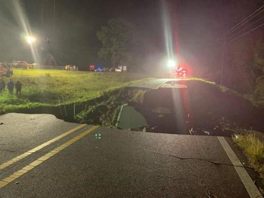Seven vehicles plunged into a giant sink hole following the failure of the roadway, all of which were retrieved by the next morning, near the Benndale community in the southeastern part of the state. (MHP Troop K. photo)