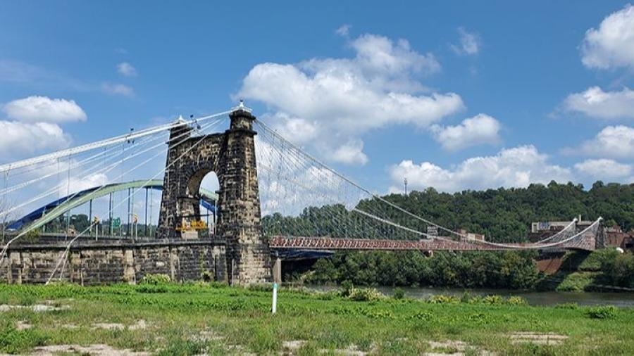 Advantage Steel & Construction LLC was awarded a contract to make necessary repairs to the historic bridge's superstructure and substructure, replace any damaged suspension cables, renovate lighting, and clean and paint the span.