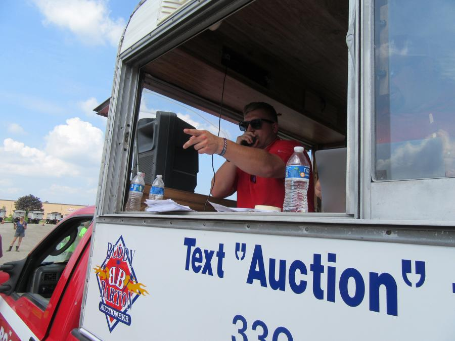 Auctioneer Austin Miller keeps the bids coming at a fast pace.