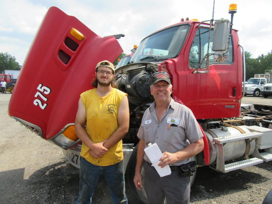 Dave Bestys (L) and Ted Vitale of Vitale Asphalt Maintenance hoped to take home a trailer from the auction.