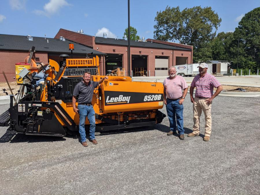 (L-R): John Geurin; Ronnie Geurin, founder of Murray Paving; and Chad Porter, salesman of Brandeis Machinery, show off the new LeeBoy 8520B paver.