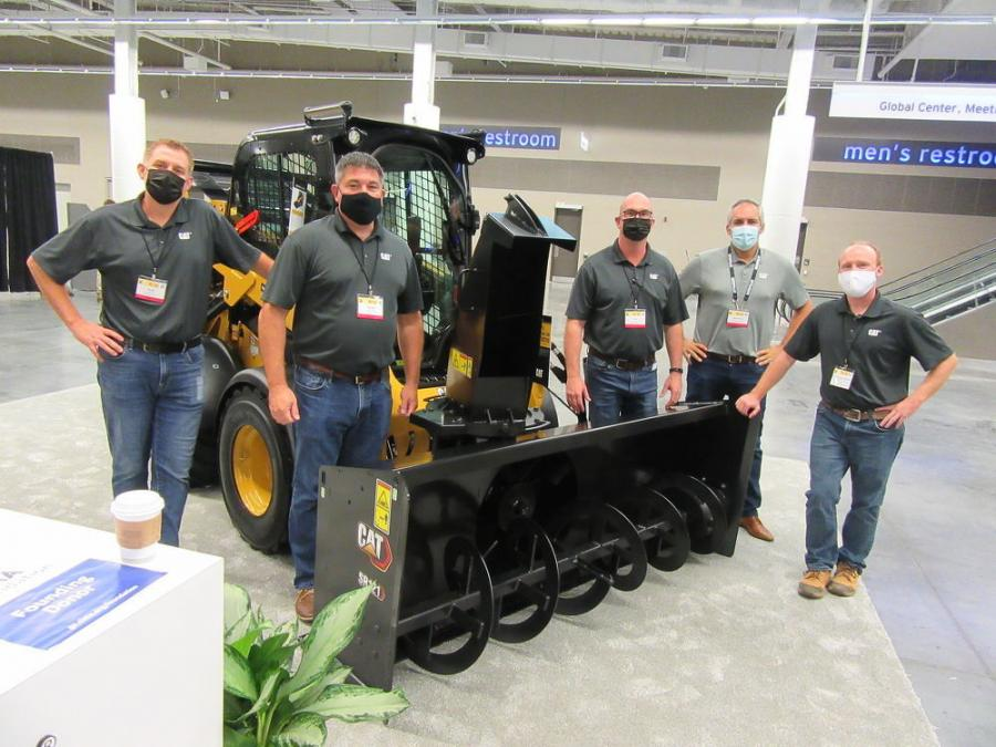 (L-R): Caterpillar representatives Scott Britton, Tharen Peterson, Andrew Kick, Juan Pedro and Erick Mangum were on hand to discuss the company's machines, which were paired with dedicated Cat attachments for snow and ice maintenance.