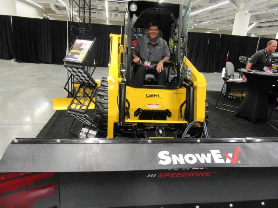SnowEx Products' Mitch Kozub was ready to discuss the company's skid steer-mounted SPEEDWING snow plow with an oscillating mount.