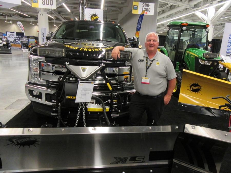 Fisher Engineering's Norm Klimko spoke with attendees in Cleveland about the company's XLS winged plow and other equipment on display.