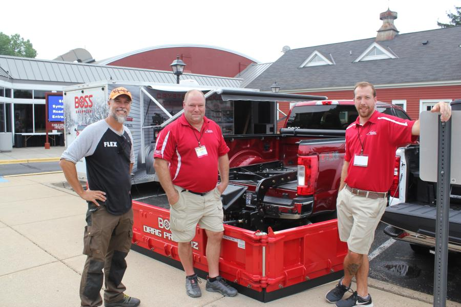 """(L-R): Stanley """"Dirt Monkey"""" Genadek receives information on the new Boss DRAG PRO 180Z with Crysteel Truck Equipment's Andy Heinecke, outside sales, and Daron Fromm, sales manager. Crysteel Truck Equipment of Fridley, Minn., is a Midwest Boss dealer.  The DRAG PRO 180Z mounts from the rear using a universal fifth-wheel rail system and a receiver hitch, allowing the operator to pull snow from the back while clearing large areas like commercial parking lots. Rotating wings allow the operator to adjust quickly to various plowing situations, surface areas and job types."""